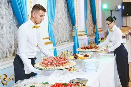 Waiter serving food at an event