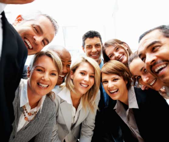 Group of colleagues clicking selfie together